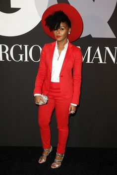 Great example of more classic styling done in a gamine way. Basic suit and white shirt say Classic - but she's done it in an out there color, and her accessories are much more fun and funky than traditional.
