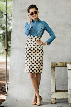 Shop this look on Lookastic:  http://lookastic.com/women/looks/dark-brown-sunglasses-blue-denim-shirt-beige-pencil-skirt-tan-heeled-sandals/9672  — Dark Brown Leopard Sunglasses  — Blue Denim Shirt  — Beige Polka Dot Pencil Skirt  — Tan Leather Heeled Sandals