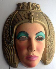 A vintage Halloween mask of Elizabeth Taylor as Cleopatra (1963).