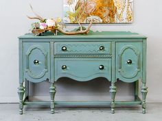 Give painted furniture an antique look using wood stain to simulate shellac darkened from age.