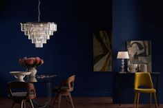 How to make a statement: ✔️ Bold chandelier from @dar_lighting ✔️ Striking blue wall ✔️ Contrasting furniture and artwork Blue Walls, Lighting, Dar Lighting, Ceiling Lights, Wall, Chandelier