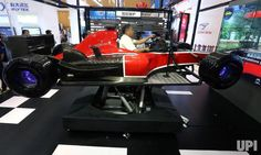 A Chinese man drives a state-of-the-art F-1 simulation race car during the World Intelligence Conference in Tianjin on June 30, 2017. The…