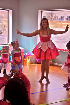 Princess Aurora teaches our party guests a dance. They got to dress up in beautiful costumes to get into character!