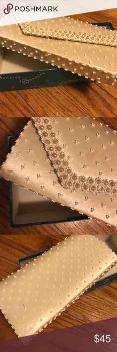 Vintage Ivory Clutch This vintage clutch is so special with just enough space for your phone, lipstick, and keys. In great condition, a few stains and one missing bead, all pictured. I feel that the flaws are not very noticeable. Zipper and snap are both functional. Original box included. Perfect for a bride on her wedding day and absolutely gorgeous! Let me know if you have any questions 😊 Vintage Bags Clutches & Wristlets