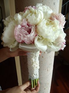 Pink and White peonies with a pearl and lace beaded trim on the bride's bouquet