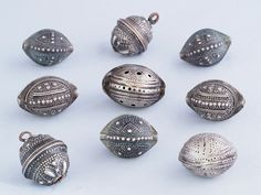 "Antique silver ""agrab al fadda"" beads from Mauritania."