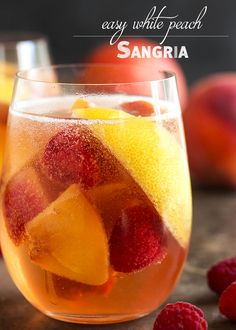 Easy White Peach Sangria – This sparkling white peach sangria is super easy to mix together and just as easy to enjoy on a warm day. Not too sweet and full of fizz from the bubbly, it's the taste of summer in a glass! Peach Sangria Recipes, White Peach Sangria, Sparkling Sangria, Peach Wine, White Wine Sangria, Margarita Recipes, Best White Sangria Recipe, Wine Drinks, Cocktail Drinks