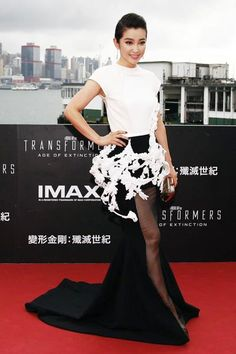 "Chinese actress Li Bingbing poses on the red carpet as she arrives for the world premiere of the film ""Transformers: Age of Extinction"" in Hong Kong June 19, 2014"