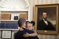 Presidential Hug. - President Obama gets the biggest of hugs from an adorable girl with adorable pig tails in the White House. 4/2014