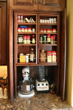 Genius!!! Spice rack in the front, open that up to more shelving for baking goods in the back!!!