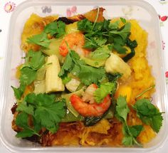 Hers; leftovers of spaghetti squash and Thai king prawn and mango curry