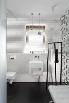 Minimalist Bathroom // Interesting use of mirrored subway tile in this minimalist bath at the House by Widawscy Studio Architektury, photo by Tomasz Borucki Dark Living Rooms, Interior, Apartment Design, White Bathroom Decor, Interior Design Secrets, Interior Design Companies, Minimalist Baths, Modern Interior Design, Bathroom Design