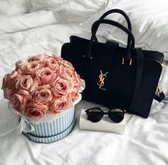 YSL bag, Chloé sunglasses, and beautiful flowers.