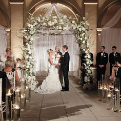 The couple wed beneath a romantic altar woven with peonies and hydrangeas...ceremony decor, metallics, neutrals, hydrangeas, peonies, wedding arch...This doesn't look too difficult to make...♡