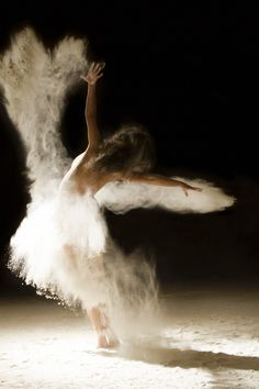 Spectacular photo set of dancers dancing in the nude with some flour to emphasize their movement. Simply stunning!