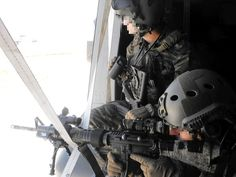 ETA SF Operators firing with their with attached ACOG attached sight from a helicopter's door. laser desigator also attached. Military Photos, Gallery