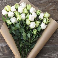 """Nothing says """"Kiss Me, I'm Irish"""" like our Green and White Roses Bouq. Our flowers ship direct from eco-friendly, sustainable farms on a Volcano to your recipient's door. With Free Delivery!"""