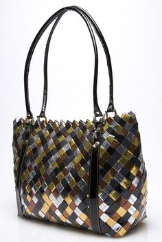 "Nahui Ollin - TWENTY 4 SEVEN METALLICS~~~Nahui Ollin is a ""green"" company that makes its purses out of candy wrappers :o)"