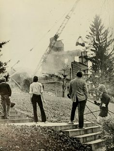 Spectrum Green yearbook, 1975.  The demolition of Ewing Hall in 1974. :: Ohio University Archives