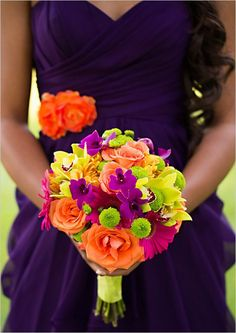 The vibrancy of this fiesta bouquet POPS against the rich purple bridesmaid dress... (and nicely complements the orange accent!)