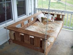 custom made barnwood furniture! swinging bed! If I had this, you might find me asleep on the porch all too often!