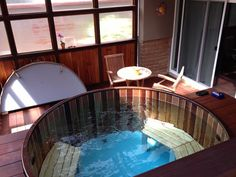 Indoor cedar hot tub.  Love the look of our new blue floors!  100% custom; choose the color and design you want!