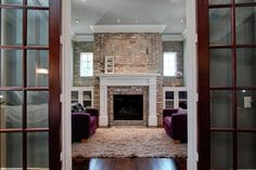 Fireplace in window wall - Houzz -West University New Orleans traditional family room