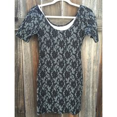 Black and gray lace tight dress Black and gray lace print tight dress. Super cute with heels for a night out ! Dresses