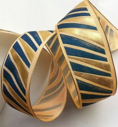 A stunning vintage, French wired ribbon. The abstract design is printed in teal and metallic gold. A fine metallic chainette runs along each edge through which is threaded a super fine wire, enabling the ribbon to hold its shape. Hat Boxes, Wired Ribbon, French Vintage, Ribbons, Teal, Antiques, Prints, Design, Bias Tape