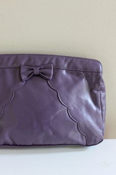Vintage bow clutch with scalloped stitching $24