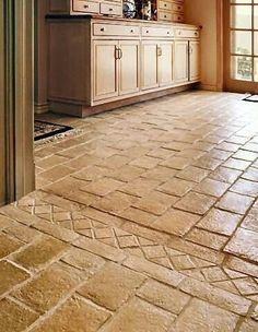 beautiful tile floor. think this is a kitchen, but would be pretty