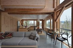 """""""We believe that architecture should represent current technologies and methodologies while at the same time using lessons from the past,"""" McCullough says. Photo 3 of 5 in An Eco-Friendly New Hampshire Home Stands Out for its Simplicity by Diana Budds Hampshire House, New Hampshire, Living Area, Living Spaces, Living Room, Interior And Exterior, Interior Design, Cabin Design, Cabins In The Woods"""