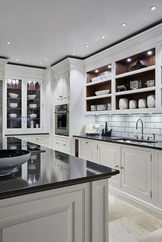 Like the shadow gap at the top and the downlighting along the edge of the cabinets