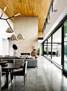 The ground floor features a towering timber-clad ceiling, a 16-metre-long wall of floor-to-ceiling glass and seamless extension to the outdoor deck. Photography: Derek Swalwell   Styling: Caroline Lieu   Story: Belle