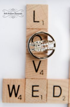 Scrabble game pieces with wedding rings
