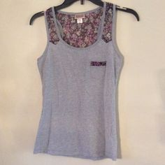 Mossimo Floral Tank XS Cute for Spring! Like New Mission Floral Purple Tank XS! Very Cute!  If you have any questions feel free to ask!  Thanks for looking! Make an offer! BUNDLE 3 items in my Closet and receive 30% off at Checkout All purchases Come with a surprise gift! Thanks for shopping Posh!  Mossimo Supply Co Tops Tank Tops