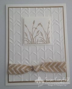 "By Susan Campfield. Dry emboss a white cardstock panel in the ""Arrows"" embossing folder (Stampin' Up). Stamp the grass from ""Wetlands"" (Stampin' Up) in Crumb Cake ink. Pop up on a white mat; then attach to the dry embossed panel. Wrap Natural 5/8"" Chevron Ribbon (Stampin' Up) around the piece before attaching to Crumb Cake mat & then a white card base. Quick card but oh, so lovely!"