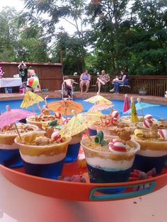 I thought it was a cute idea though :) Pool party in August! I'm so jealous right now! Sand Cups: Beach or Pool Party Treats --cute kids snack, or even adult jello shots/cup version Pool Party Treats, Snacks Für Party, Luau Party, Party Fun, Cute Kids Snacks, Blue Jello, Kid Pool, Summer Treats, Beach Treats