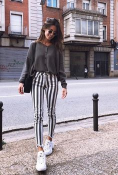 tucked grey sweater with striped skinny pants