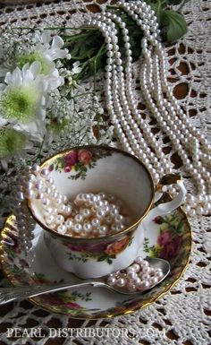 #pearls in fine china teacup with pearl necklace