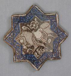Star-Shaped Tile,  ca. 1300.    Kashan, Iran.   Stonepaste; overglaze luster-painted.