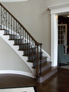 gray stairs with white risers - Google Search Black Stair Railing, Wrought Iron Stair Railing, Stair Banister, Curved Staircase, Staircase Design, Black Stairs, Banisters, Railings, Iron Balusters
