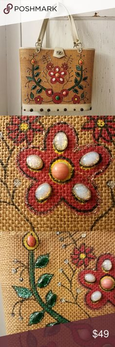 "Vintage 50s bag by Donna John Wind basket straw This awesome vintage bag has a stiff woven brown burlap overlay with ivory trim and handles. It has a wood bottom. It has the cutest flower and jewels embellishments on the front! The tag reads "" Bag by Donna  A Division of John Wind  Made in Japan"". This purse dates from about the 1950s. It does show its age with surface wear and water stains on the straw part, but overall still has a lot of life and charming as is! From a smoke free home:)…"