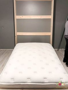 Murphy bed frame open up with mattress sitting inside of it