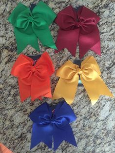 "A big bow to add the finishing touches to your gameday outfit or for the little belle in your life. 7.5"" L x 8"" H 2.25"" Alligator Clip Grosgrain Ribbon"