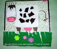la vache : déchirer des morceaux de papier noir et coller sur le corps de la vache. Collage des différentes parties du corps à la manière d'un puzzle.