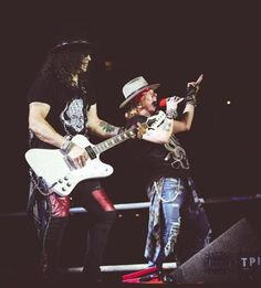 Slash and Axl Rose on stage Tuesday in Foxborough.