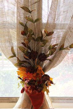 The curtains were burlap panels tied with colorful napkins and fall stems...