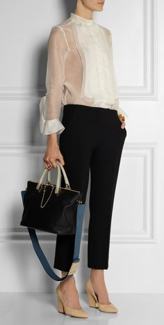 """Chloé's 'Baylee' Tote was described by creative Director Clare Waight Keller as """"simple"""" and """"chic"""". This black leather version comes complete with an optional shoulder strap for styling versatility. We love the thoughtful Detailing too - the top zips are linked by a Gold Chain which can be detached and worn as a Bracelet.  Shown here with 