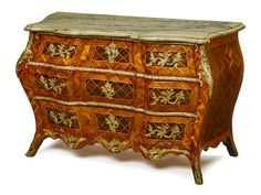 A Swedish Rococo gilt bronze mounted parquetry inlaid walnut commode in the manner of Christian Linning third quarter 18th century